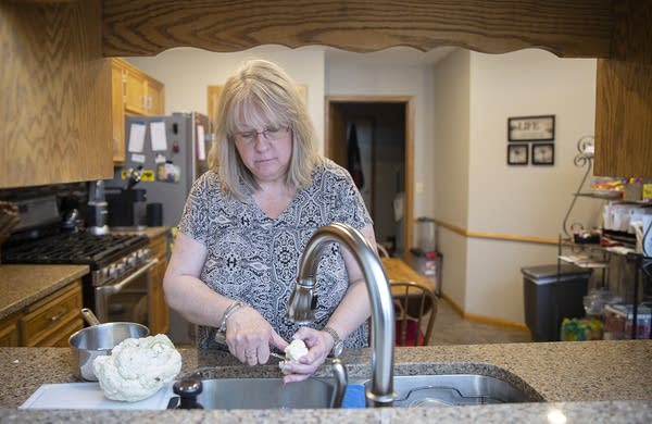 Lynn Cordova makes dinner at her single-level townhome in Apple Valley.