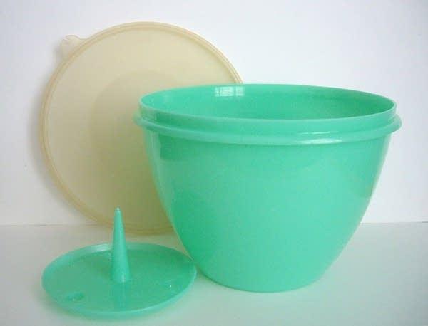 Green Tupperware lettuce crisper bowl with lid and spike for bottom