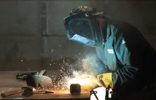 Sparks fly as Nick Bounds creates a new gate key with a welding torch.