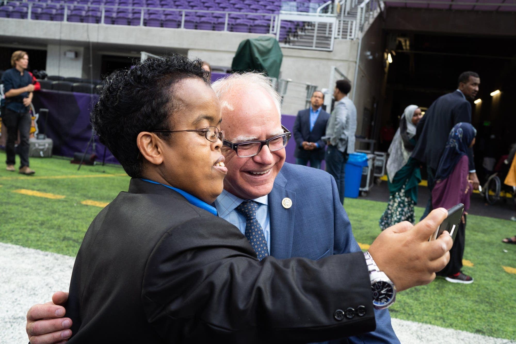 DFL gubernatorial candidate Tim Walz takes a selfie with Abdi Abdulla.