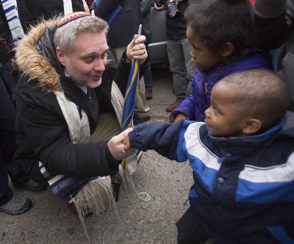 Rabbi Michael Adam Latz befriends several children