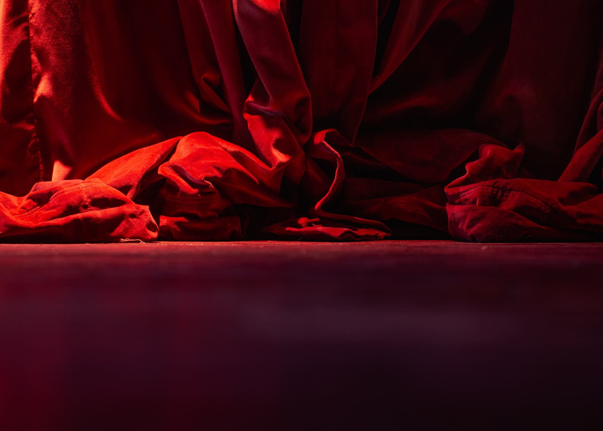 Daylight shines onto Icehouse's stage and a bunched-up red curtain.