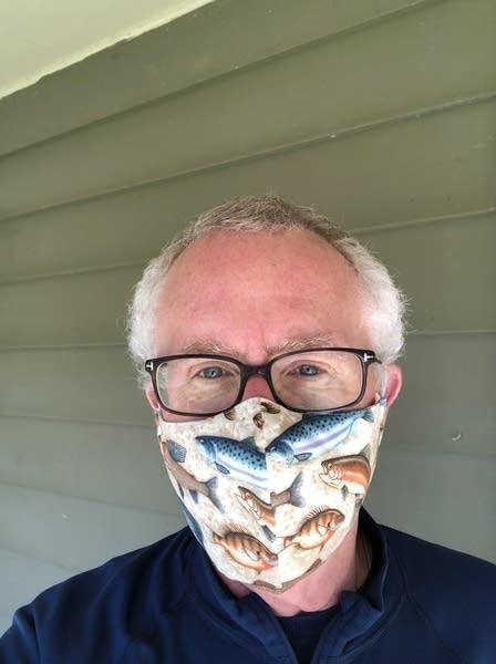 A man wears a handmade face mask