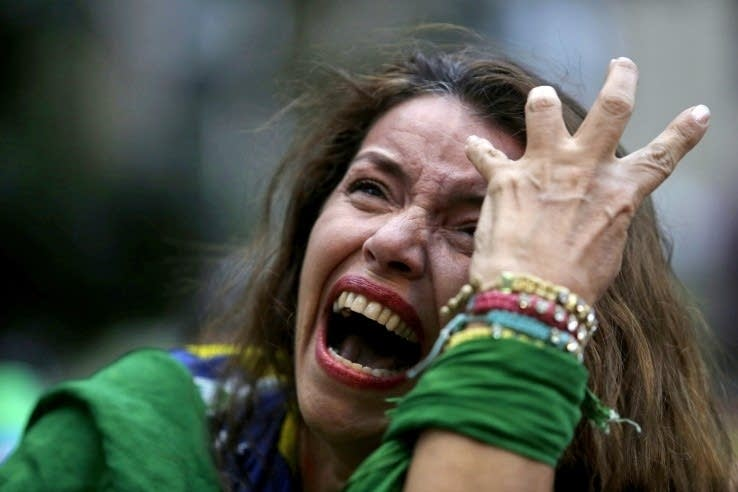 A Brazil soccer fan cries