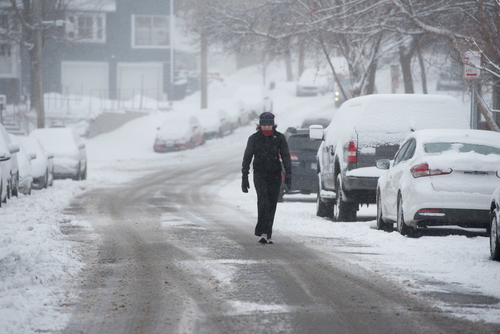 Margot Brownell of Edina walks down the middle of West 44th Street.