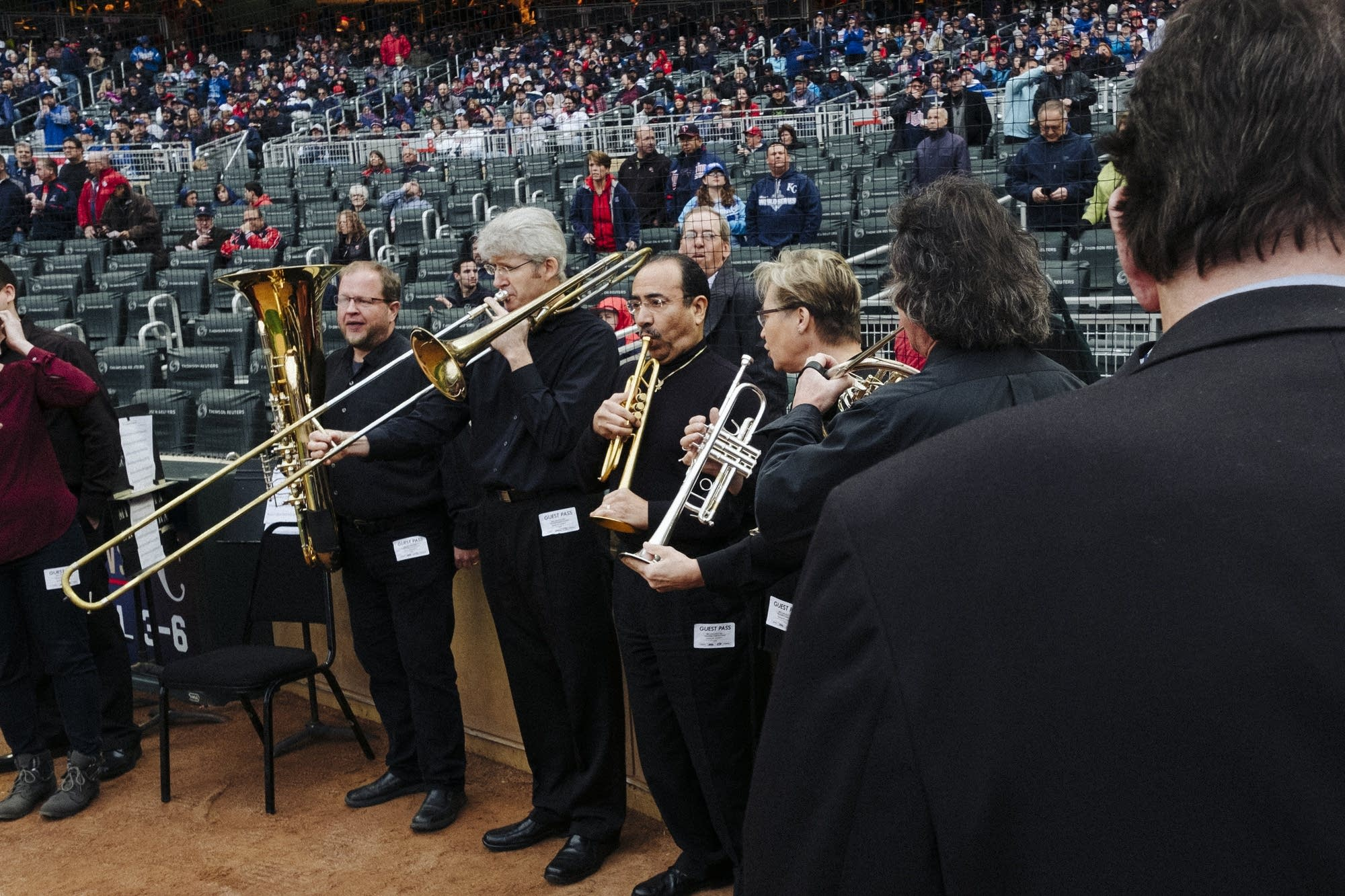 Members of the Minnesota Orchestra warm up.