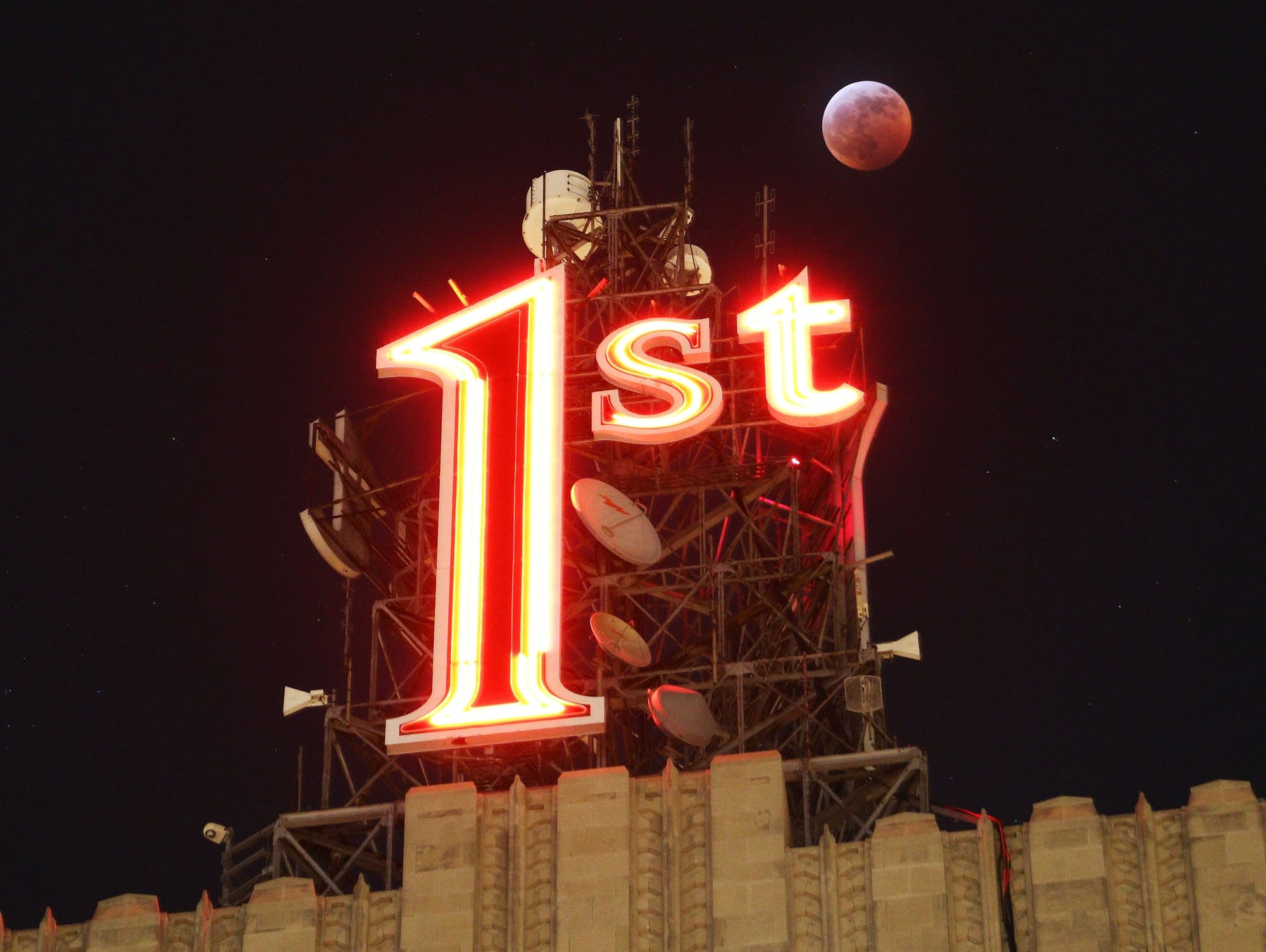 The super blood wolf moon is visible above St. Paul