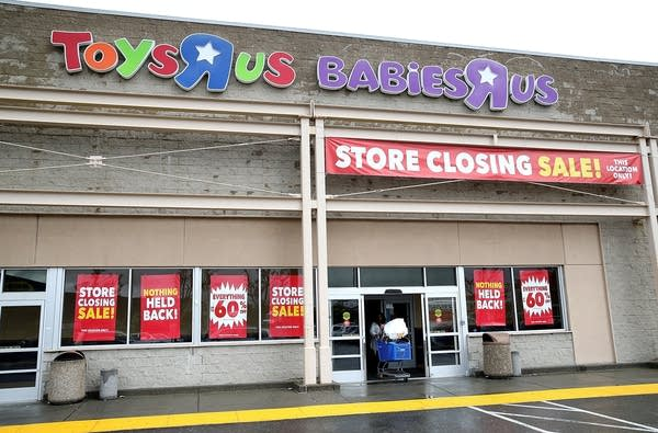 A customer leaves a Toys R Us store on March 15, 2018