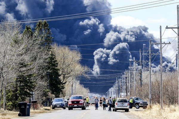 People evacuate the area after a second major series of fires.