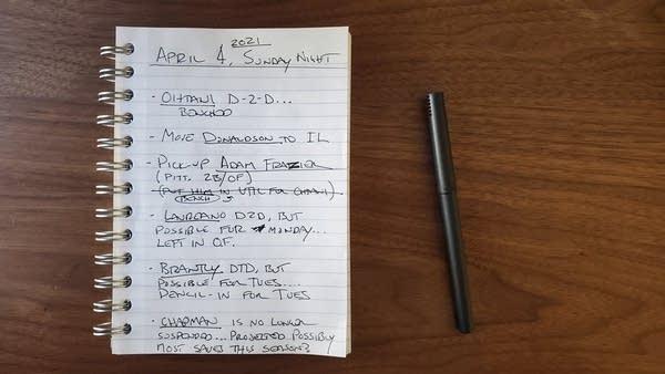 Spiral notebook with random fantasy baseball scribbles
