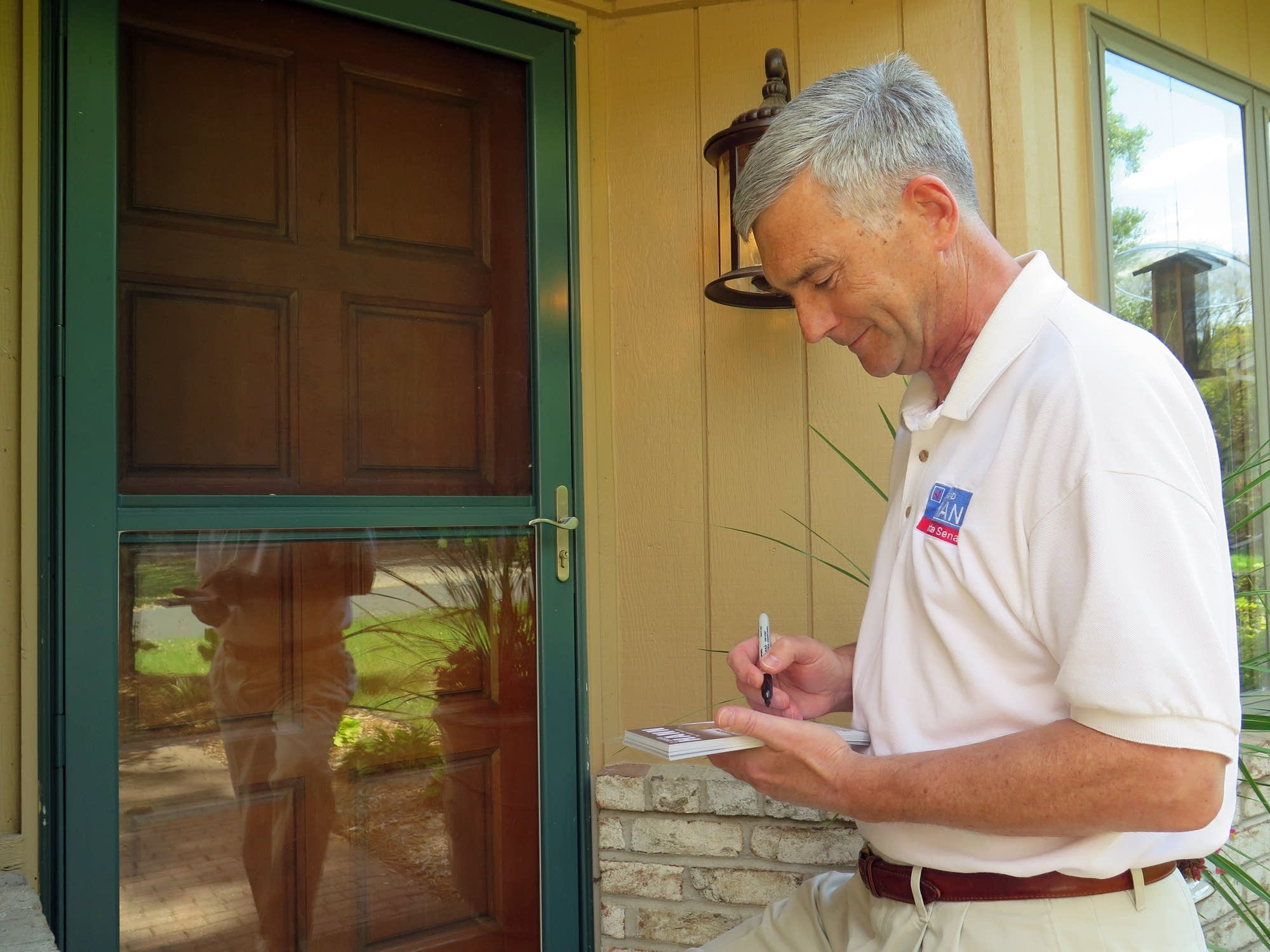 Republican state Sen. David Hann writes a note.