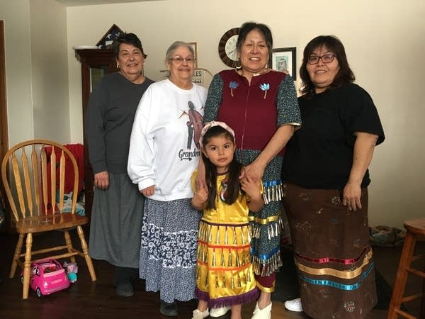 A Native American family stands for a portrait.