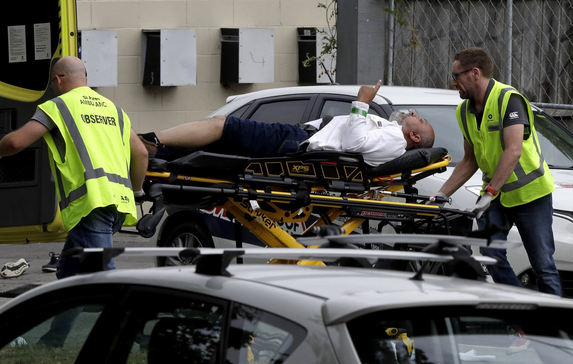 Ambulance staff take a man from outside a mosque in Christchurch.