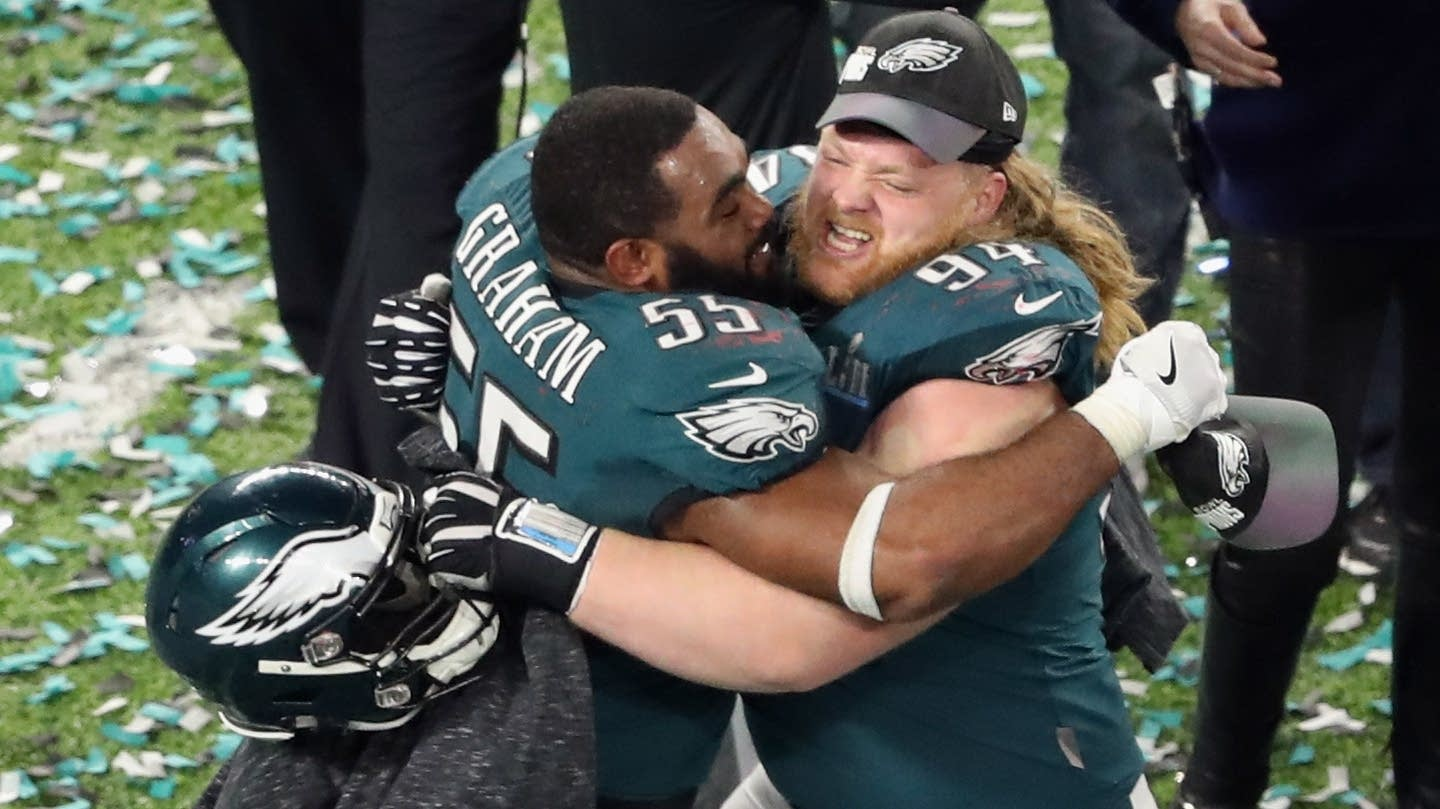 Brandon Graham and Beau Allen, right, celebrate.