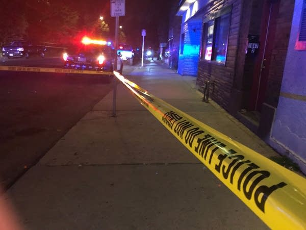 Police tape marks the scene where a man was fatally shot