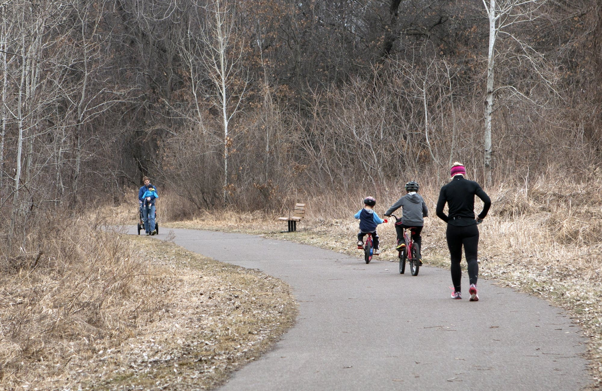 Walkers and bikers fill the trails instead of cross-country skiers.