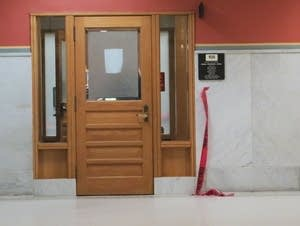 The shooting occurred in an interview room at City Hall.