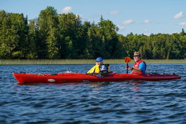 Pat Marble, who's turning 107 in August, kayaks on Island Lake in Northome