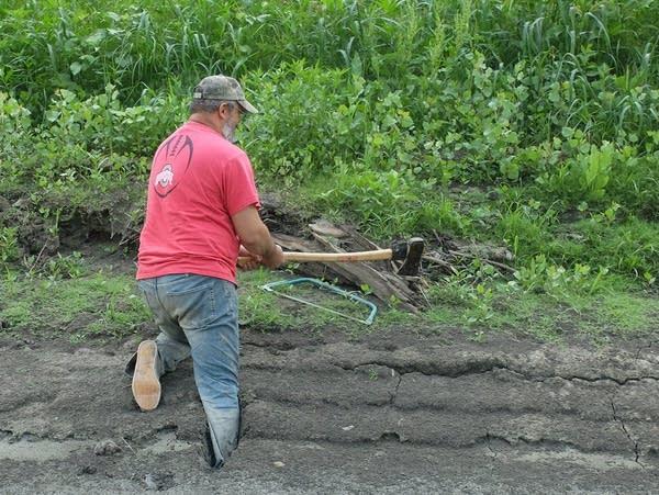 a man using an axe to cut wood