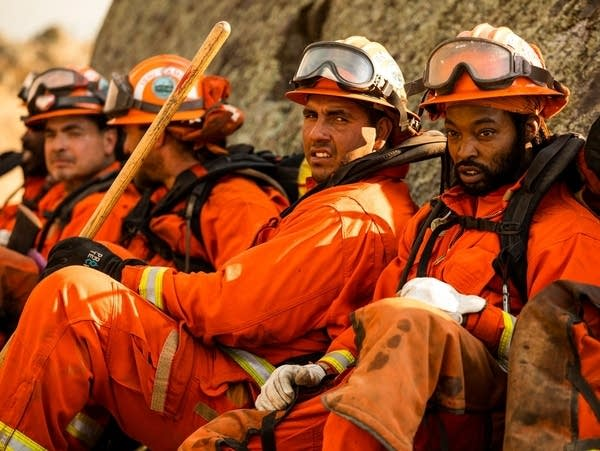 A crew of inmate firefighters takes a break