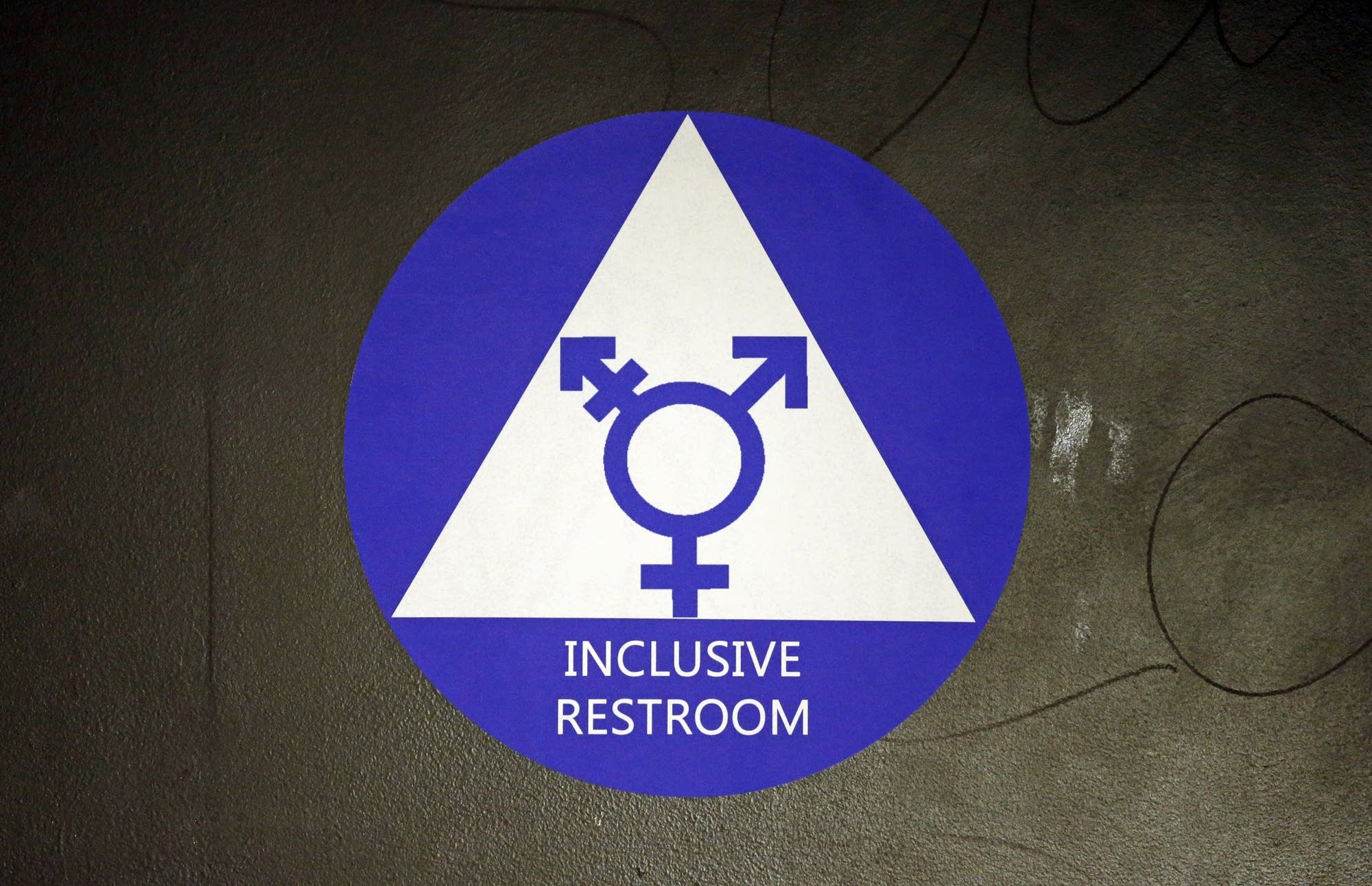 A new sticker designates a gender neutral bathroom