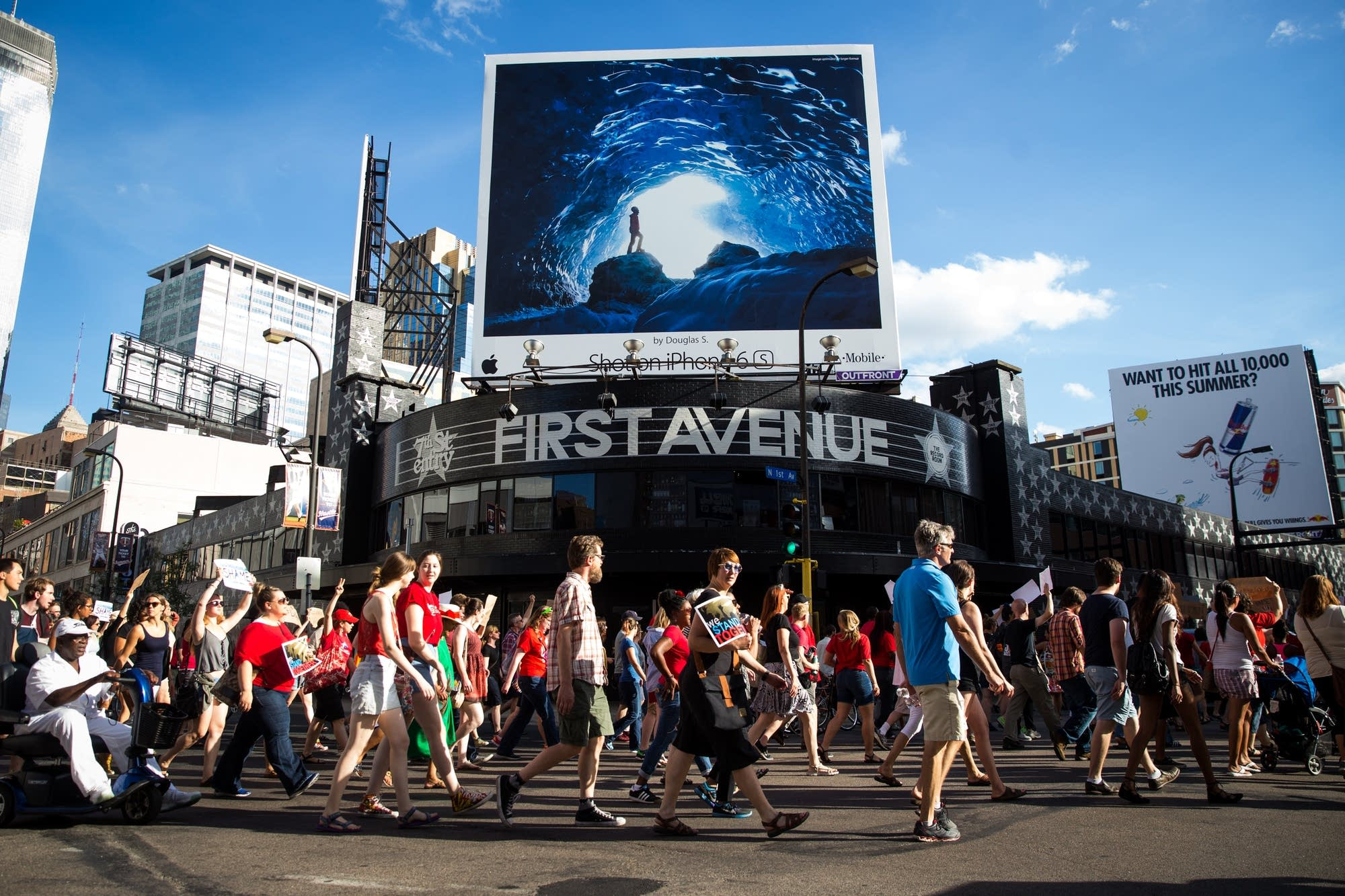 Protesters march past First Avenue.