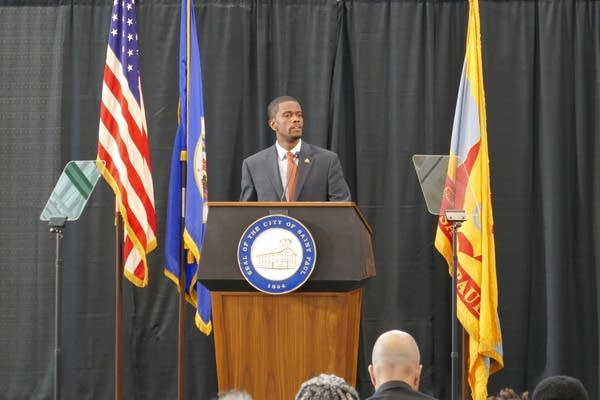 Mayor Melvin Carter speaks at a podium