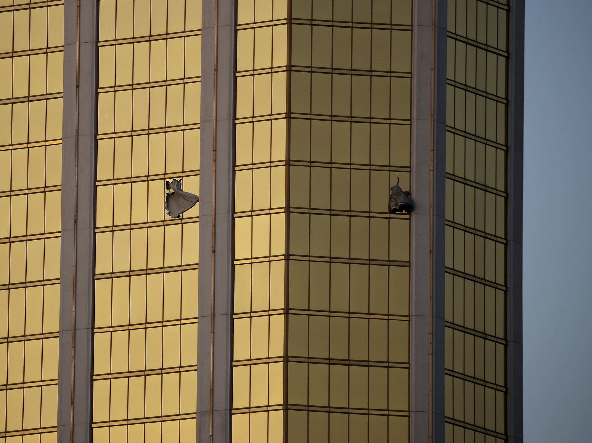 Drapes billow out of broken windows at the Mandalay Bay resort.