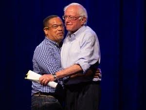 Rep. Keith Ellison and Sen. Bernie Sanders hug.