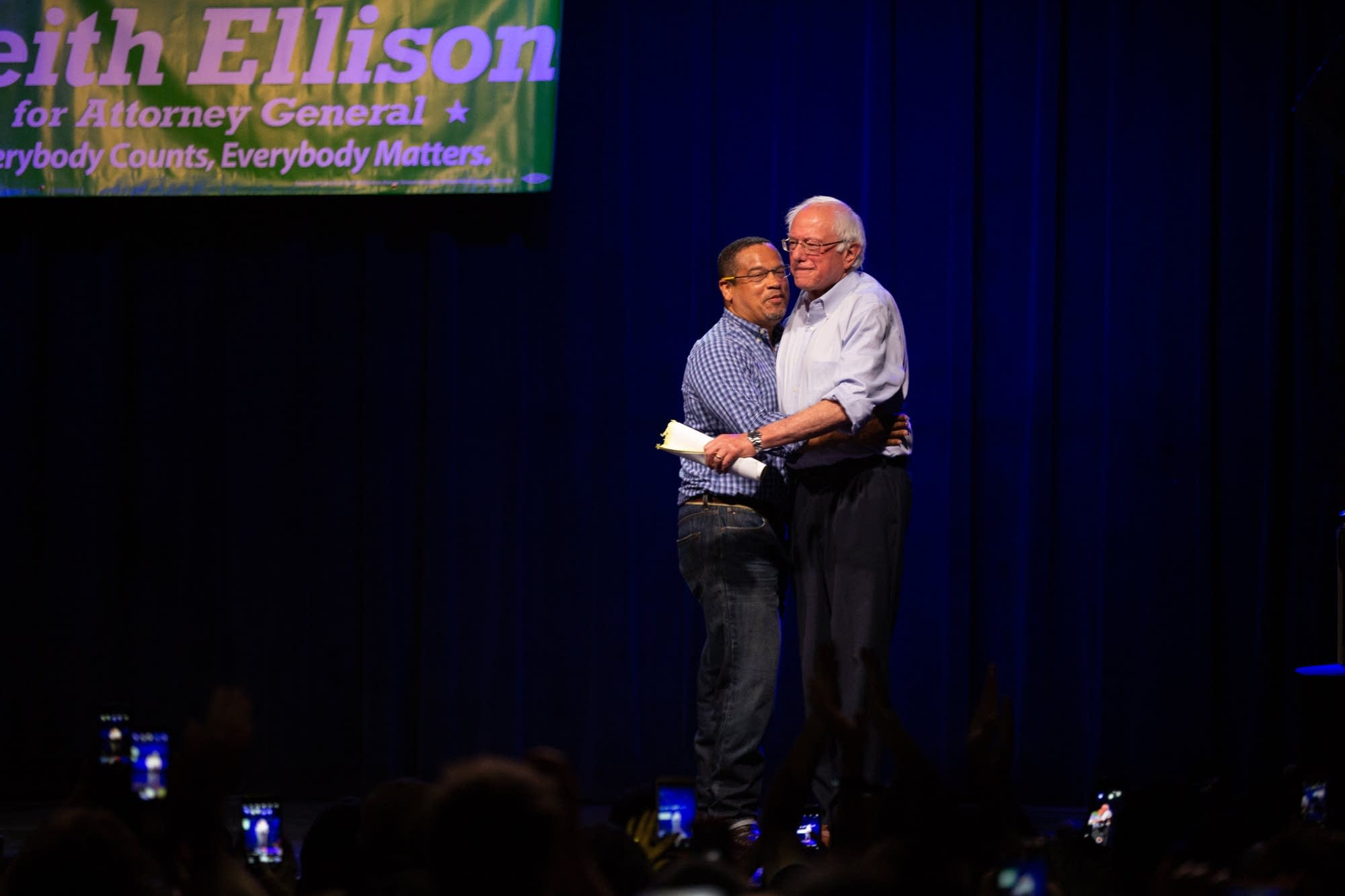 Rep. Keith Ellison and Sen. Bernie Sanders hug.