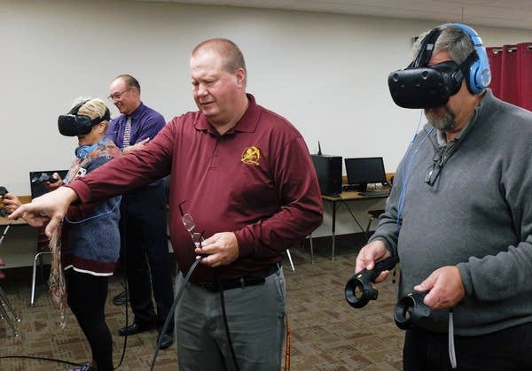 Superintendent Phil Jensen tries to navigate a virtual reality scene.
