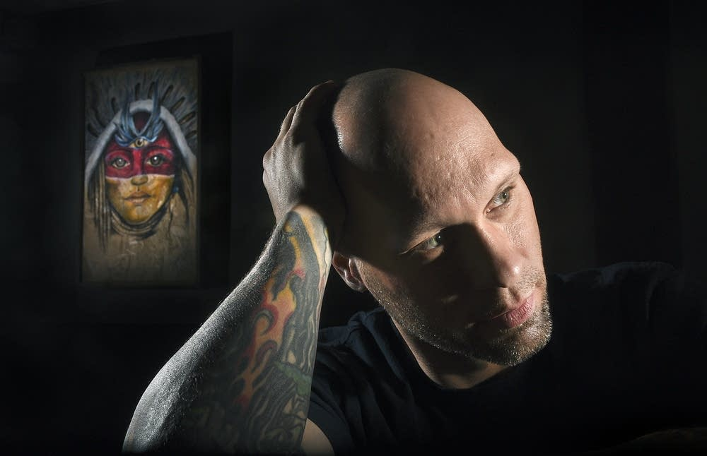 Michael Hansen at his tattoo shop in Northfield