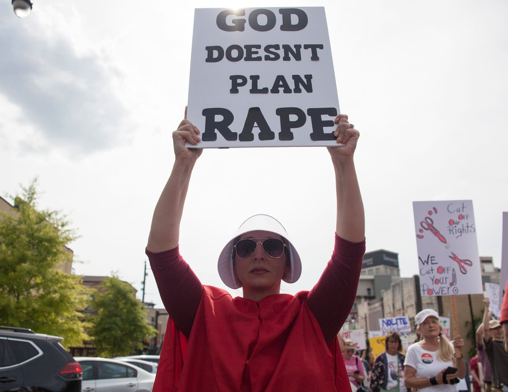 A protester holds a sign outside the Alabama state Capitol.