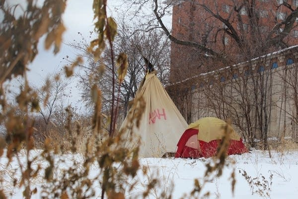 Tents sit in the snow