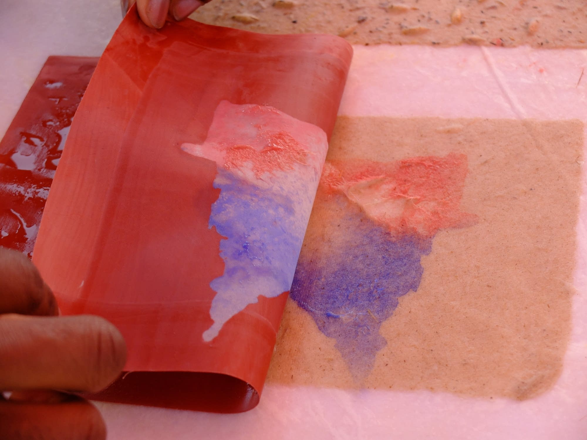 Colored paper pulp is used to make images on freshly made paper.