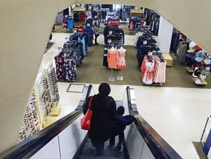 A woman and child ride the escalator at a Sears store in St. Paul.