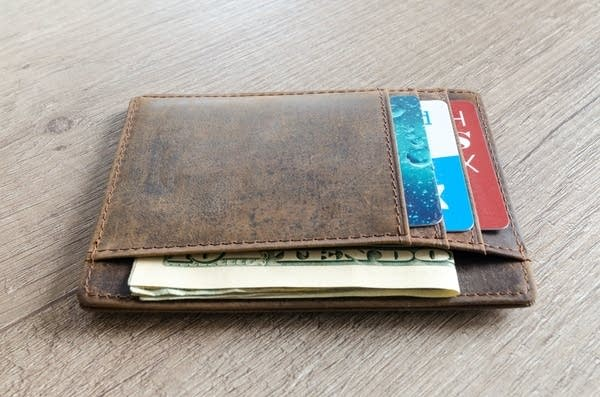 A wallet with money in it.