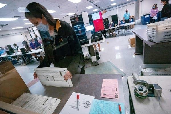 A poll worker sorts ballots.