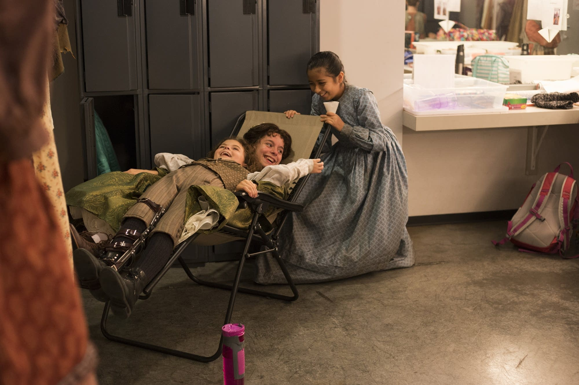 Sophie Jones, Elena Ruch and Carolina Sierra play in their dressing room.