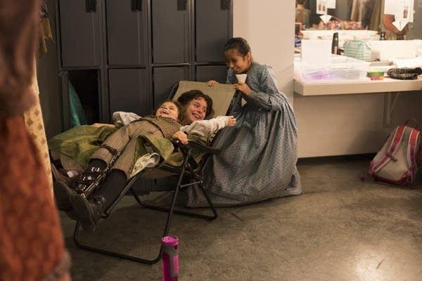 Sophie Jones, Elena Ruch and Carolina Sierra play in their dressing room.