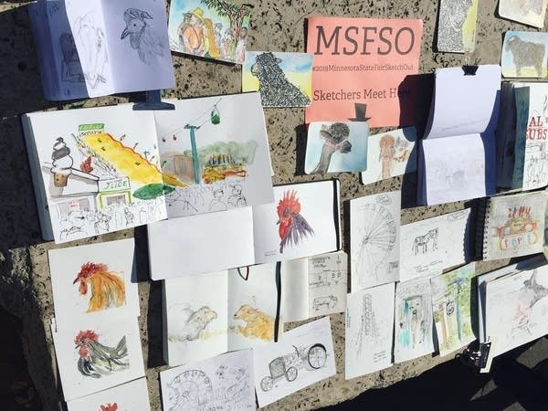 Drawings are pinned to a board at the State Fair