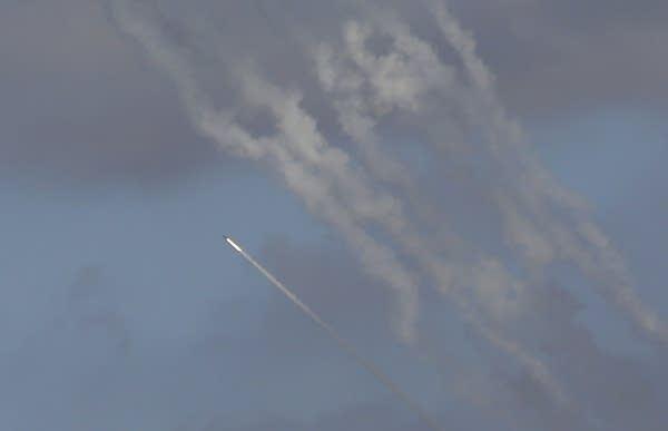 Rockets seen in the sky.