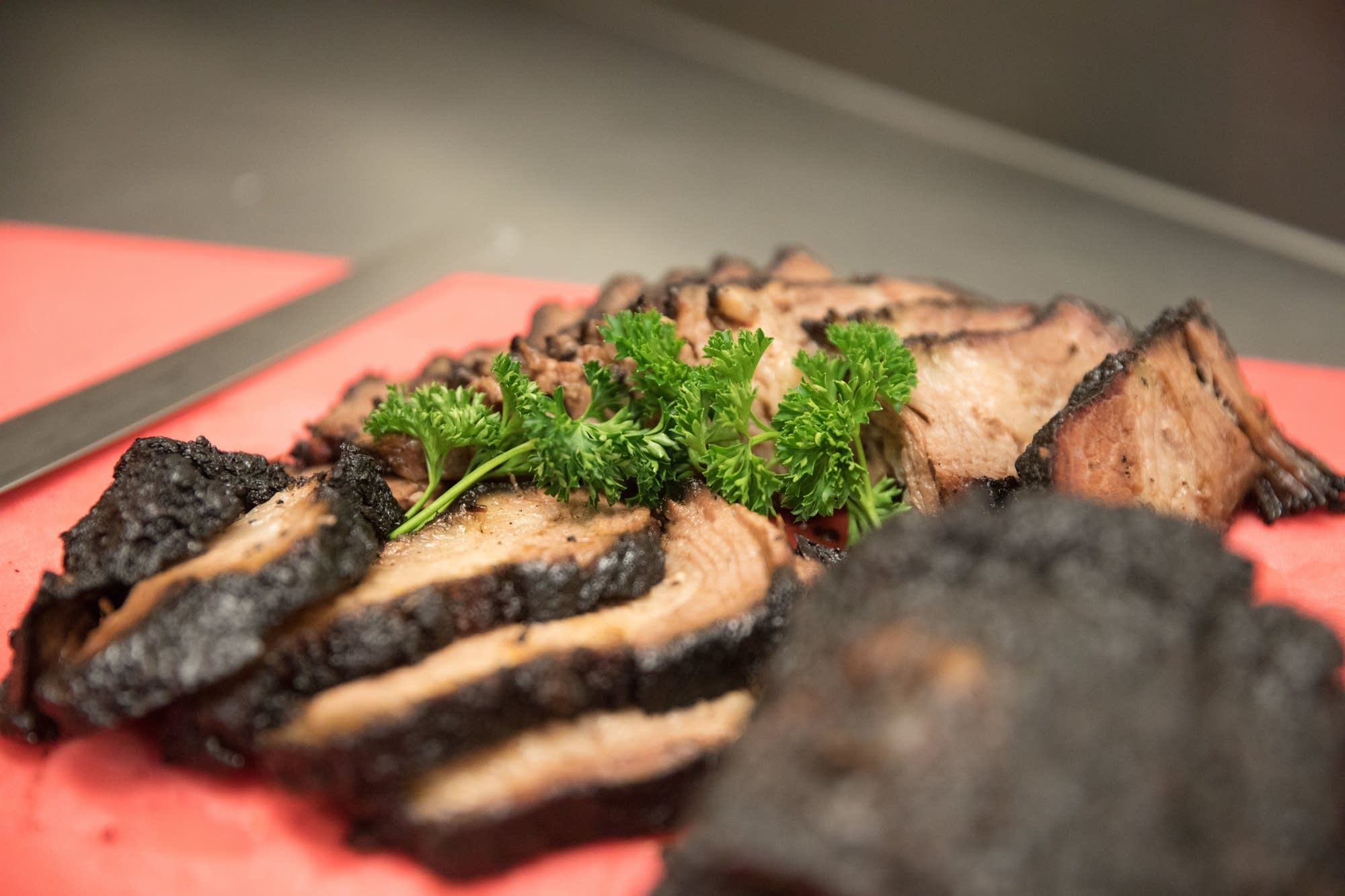 Beef brisket is served to members of the Onyx Culinary Collective.
