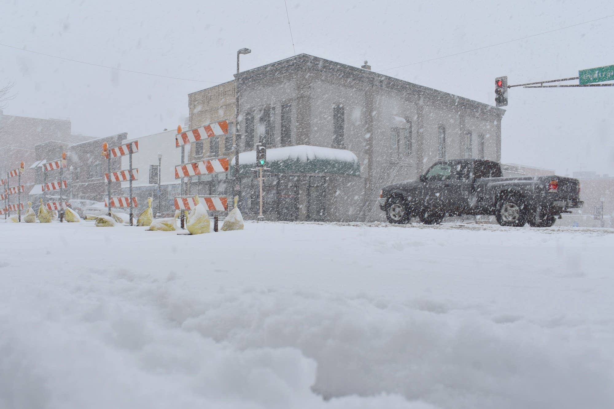 Snow falls at a heavy rate in Faribault, Minn. on Wednesday.