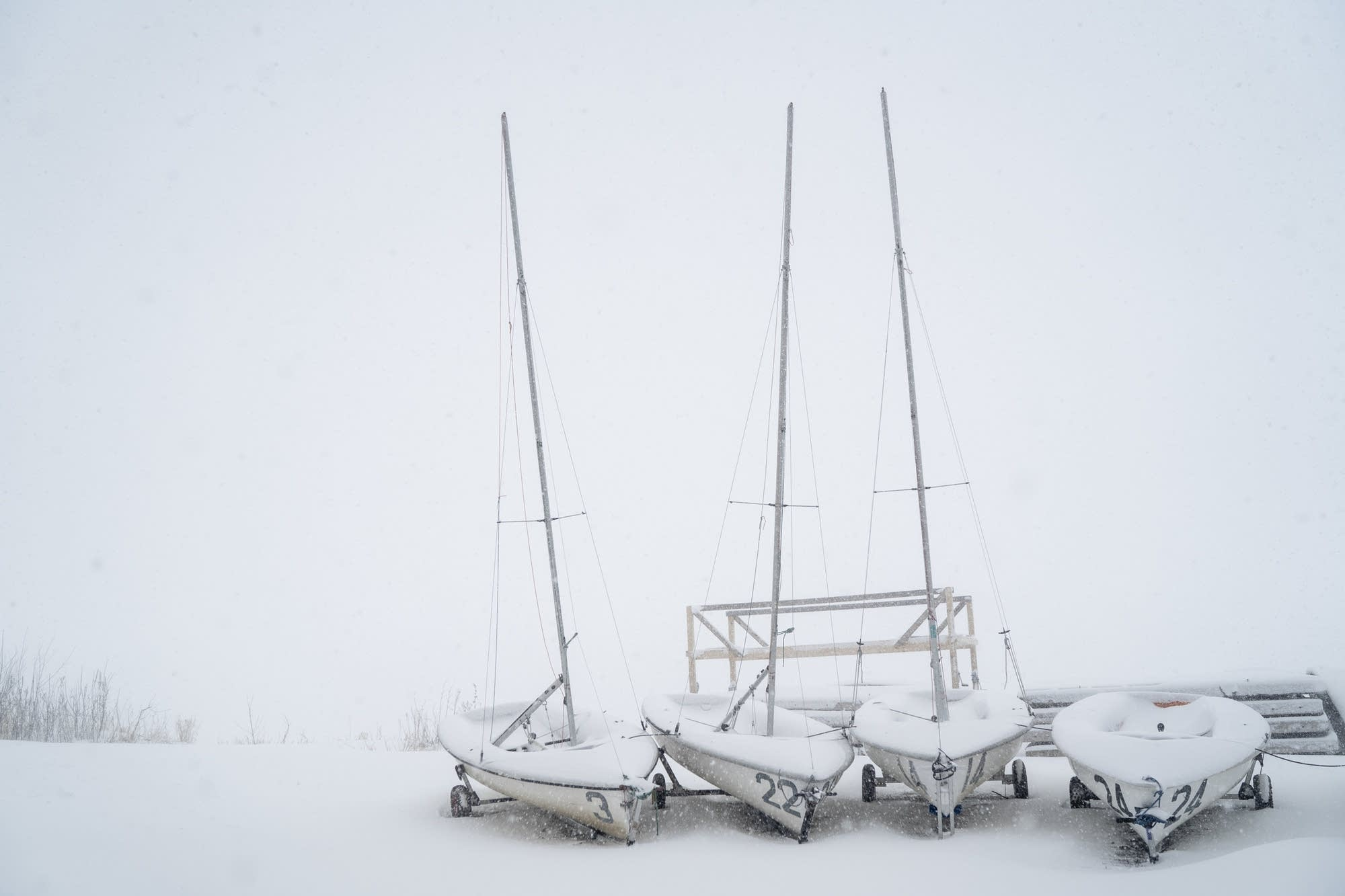 Snow assails boats on the shore of Bde Mka Ska.