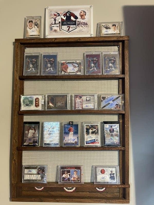 baseball cards on a shelf