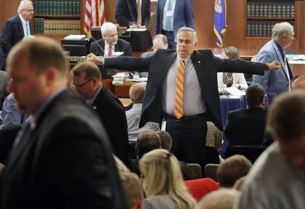 Rep. Tony Albright stretched during break.