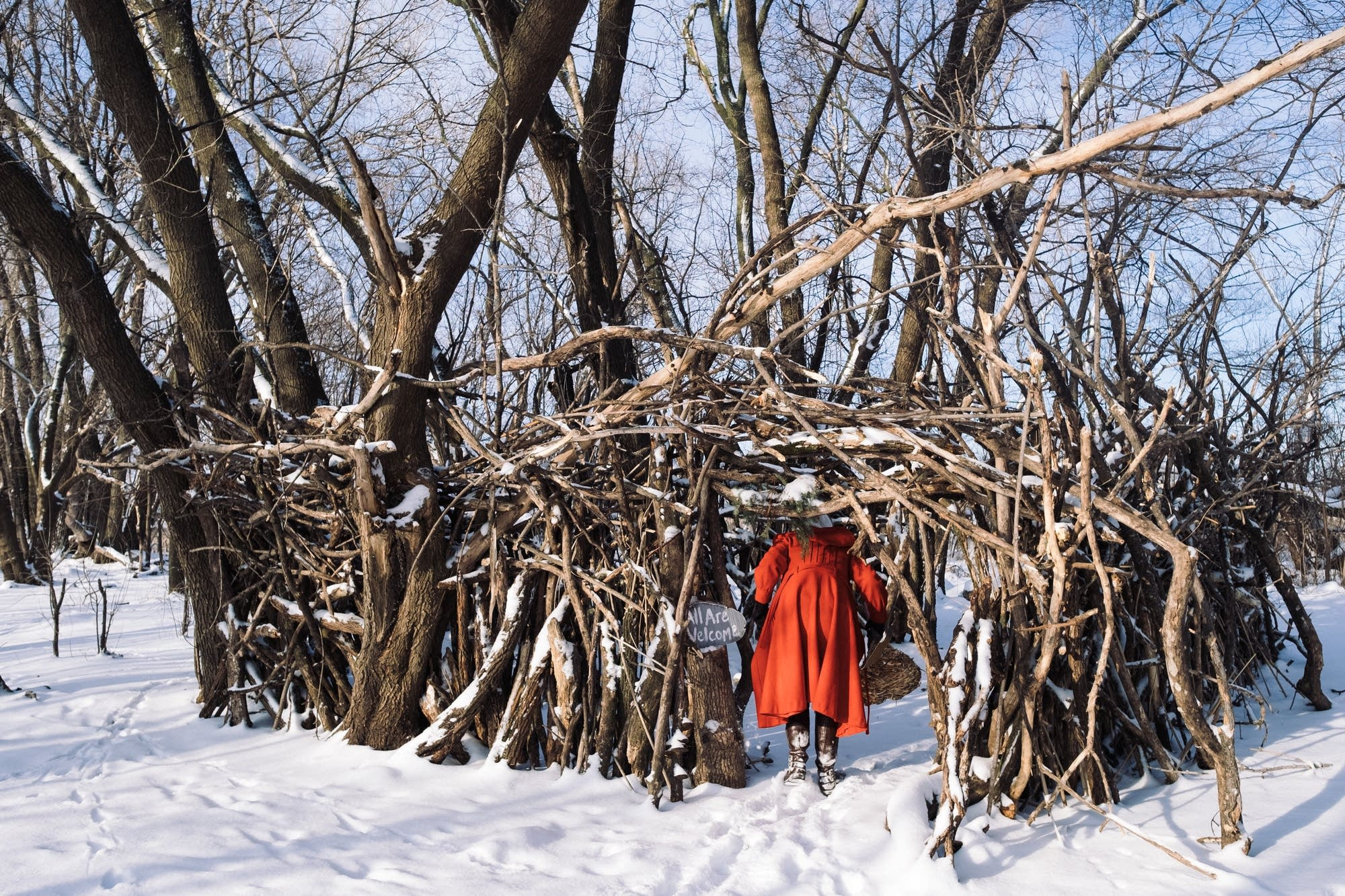 Katie Carrot enters a stick fort near MSP International Airport.