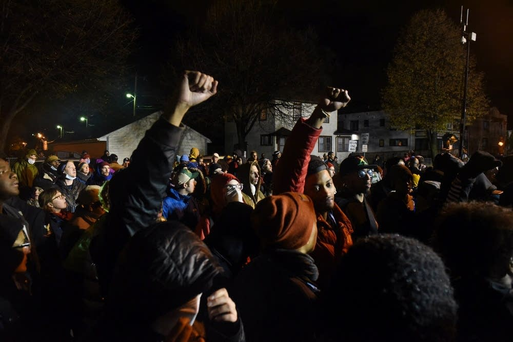 Protesters chant outside the 4th Precinct.
