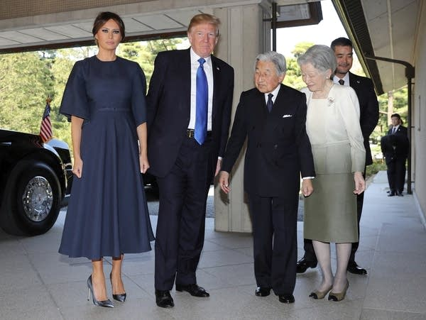 President Trump welcomed by Emperor Akihito at Imperial Palace.